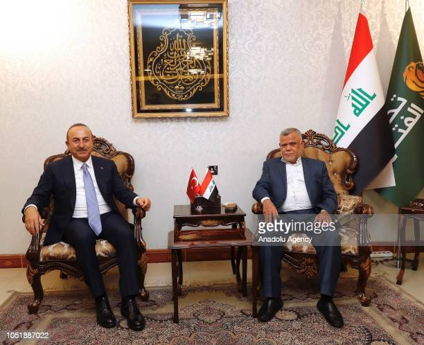 Minister of Foreign Affairs of Turkey Mevlut Cavusoglu meets with leader of Badr Organization Hadi AlAmiri in Baghdad Iraq on October 11 2018