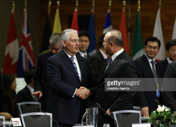 Minister of Foreign Affairs of Turkey Mevlut Cavusoglu shakes hands with US Secretary of State Rex Tillerson during Vancouver Foreign Ministers...