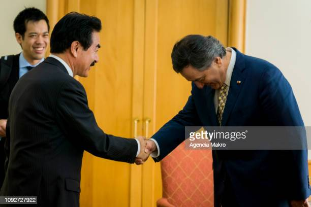 Minister of Foreign Affairs Roberto Ampuero says goodbye to the Minister of State for Foreign Affairs of Japan Masahisa Sato at the end of a working...