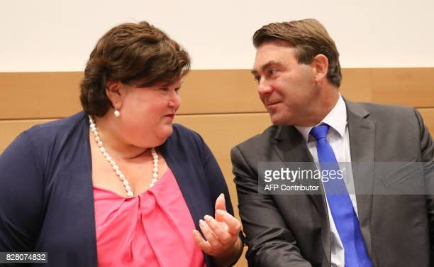 Minister of Health and Social Affairs Maggie De Block and Minister of SMEs Entrepreneurs Agriculture and Social Integration Denis Ducarme talk during...