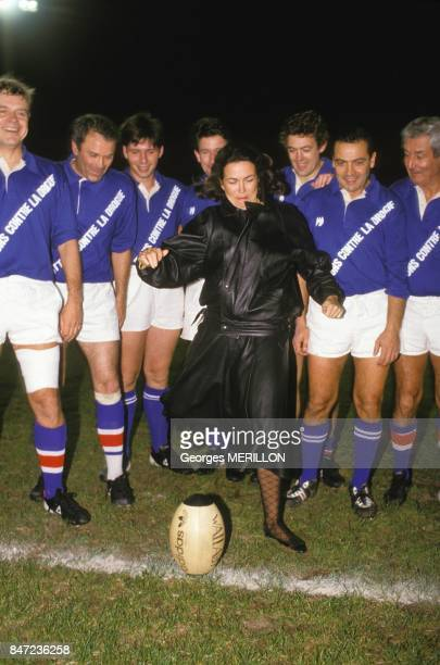 Minister of Health Michele Barzach kicking off rugby match between journalists and polticians on October 17 1987 in France