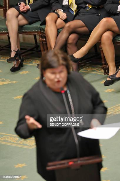 Minister of Health Social Affairs Asylum Policy and Migration Maggie De Block and the legs of Chamber personnel pictured during a plenary session of...