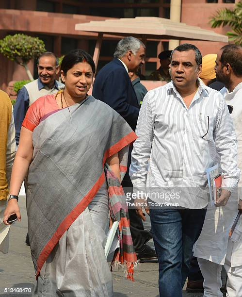 Minister of Human Resource Development Smriti Irani and BJP MP Paresh Rawal during Budget session at Parliament house in New Delhi