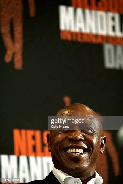 Minister of Human Settlements Tokyo Sexwale smiles during a press conference at the Nelson Mandela Foundation on June 20 2011 in Johannesburg South...
