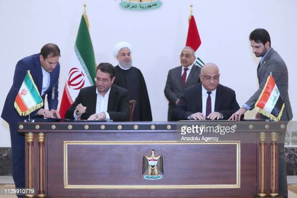 Minister of Industry Mines and Business of Iran Reza Rahmani and Iraqi Trade Minister Mohammad Hashim attend a signing ceremony in the presence of...