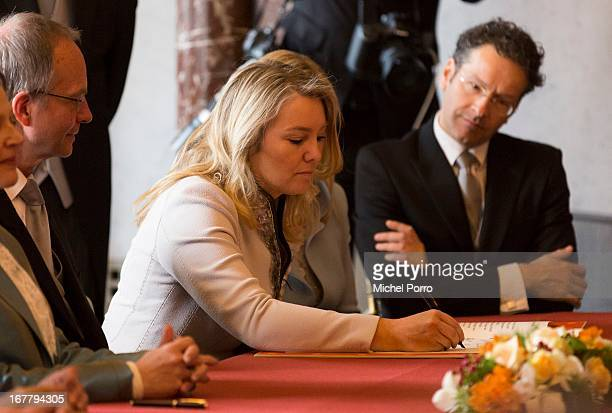 Minister of Infrastructure and the Environment Melanie Schulzvan Haegen signs the Act of Abdication of Queen Beatrix of the Netherlands in the...