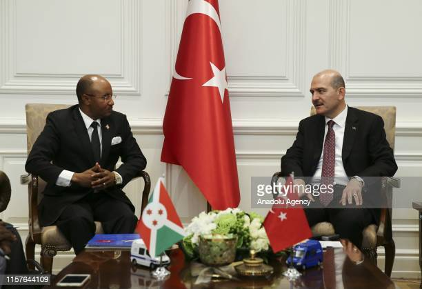 Minister of Interior of Turkey Suleyman Soylu chats with Burundian Minister of Public Security and Disaster Management Alain Guillaume Bunyoni during...