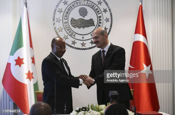 Minister of Interior of Turkey Suleyman Soylu shakes hands with Burundian Minister of Public Security and Disaster Management Alain Guillaume Bunyoni...