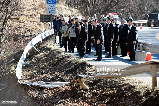 Minister of Land Infrastructure Transport and Tourism Keiichi Ishii observes a minute of silience at the accident site a day after the ski night bus...