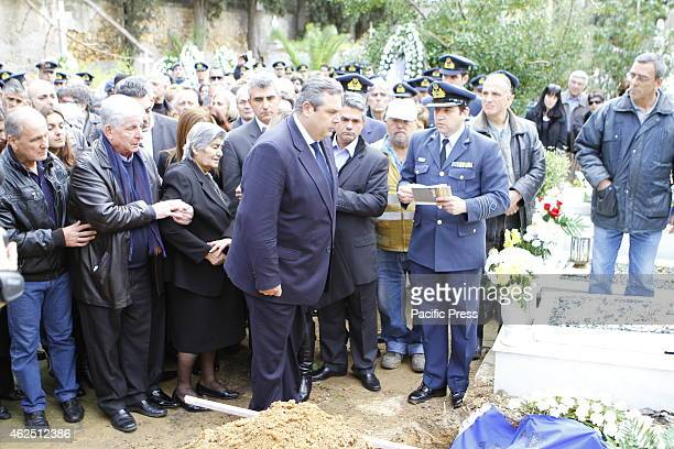 Minister of National Defence Panos Kammenos stands at the graveside paying his respect The funeral of the first of the two Hellenic Air Force pilots...
