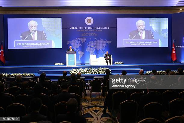 Minister of National Education of Turkey Nabi Avci delivers a speech as Minister of Foreign Affairs of Turkey Mevlut Cavusoglu sits on the stage...