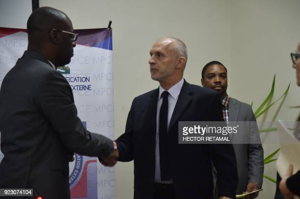 Minister of Planning and External Cooperation Aviol Fleurant shakes hands at the end of a meeting with Oxfam Regional Director for Latin America and...