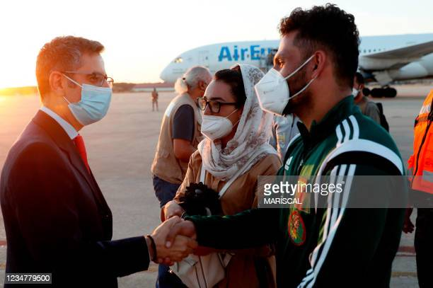 Minister of Presidency Felix Bolanos welcomes the captain of Afghanistan's women's wheelchair basketball team Nilofar Bayat and her husband Ramish...