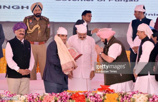 Minister of Road Transport and Highways of India Nitin Gadkari honoured by Punjab Chief Minister Captain Amarinder Singh during the foundation laying...