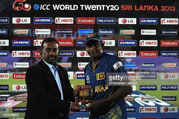 Minister of Sport Mahindananda Aluth Gamage presents Ajantha Mendis of Sri Lanka with his Player of the Match award Maduring the ICC World Twenty20...
