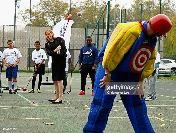 Minister of Sport Tracey Crouch aims at a target man as she takes part in Snag Golf as she visits the Sports Pavillion at The Hyde to Unveil New...