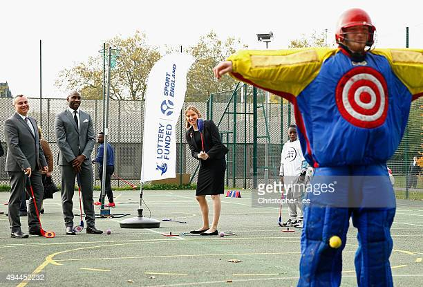Minister of Sport Tracey Crouch aims at a target man as she takes part in Snag Golf as the Sport England Director of Community Sport Mike Diaper and...