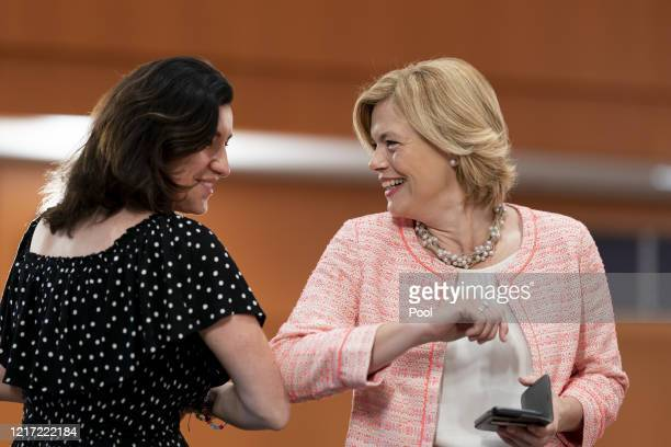 Minister of State Dorothee Bär and Minister of Agriculture Julia Klöckner greet each other with an elbow bump as they arrive for the weekly...
