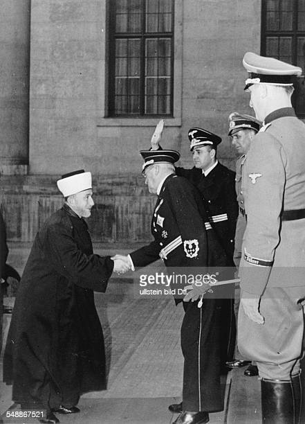 Minister of State Dr Otto Meissner head of the presidential chancellory is hsaking hands with the Grand mufti of Jerusalem Sayid Amin el Husseini in...