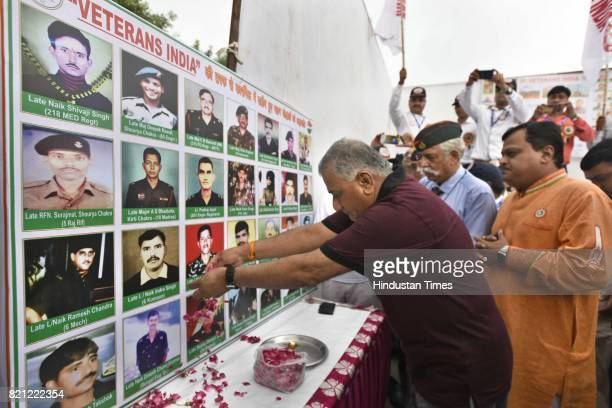 Minister of State for External Affairs General VK Singh paying tribute to the Kargil Martyrs at Yamuna Sports Complex before the Kargil Parakram...