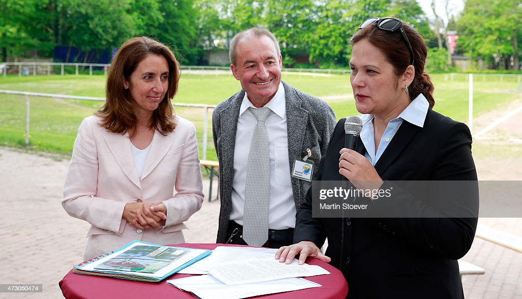 Minister Of State For Migration, Refugees And Integration Aydan Oezoguz, Siegfried Pillmann of TSV Wandsetal and Claudia Wagner-Nieberding of Hamburger Fussball Verband visit TSV Wandsetal on May 12, 2015 in Hamburg, Germany.