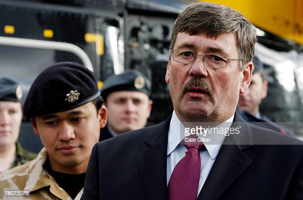 Minister of State for the Armed Forces Bob Ainsworth with troops before they load Christmas gifts donated by charity UK4UThanks onto a helicopter to...