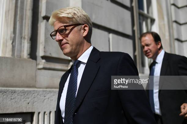 Minister of State for Universities Science Research and Innovation Jo Johnson leaves as Demonstrators gather outside Cabinet Office waving Union and...