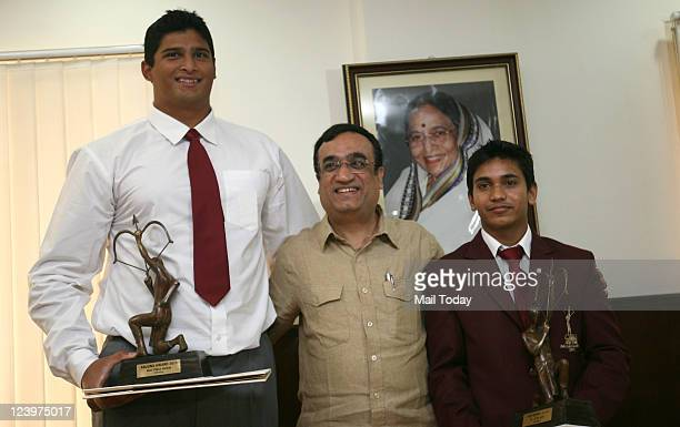 Minister of State for Youth Affairs and Sports Ajay Maken after presenting Arjuna Awards to athlete Vikas Gowda and gymnast Ashish Kumar at Shastri...