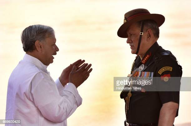 Minister of State Planning Urban Development Housing Urban Poverty Alleviation Rao Inderjit Singh talking to Indian Army Chief Lt General Bipin Rawat...