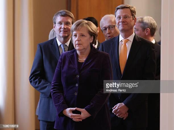 Minister of the Chancellery Ronald Pofalla, German Chancellor Angela Merkel and German Vice Chancellor and Foreign Minister Guido Westerwelle attend...