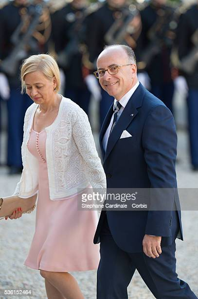 Minister of the Interior Bernard Cazeneuve and wife arrive at the State Dinner offered by French President François Hollande at the Elysee Palace on...