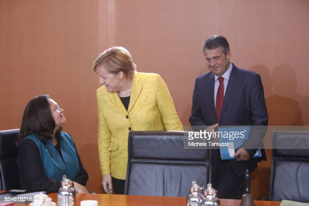 Minister of Work and Social Issues Andrea Nahles German Chancellor Angela Merkel and German Vice Chancellor and Foreign Minister Sigmar Gabriel...