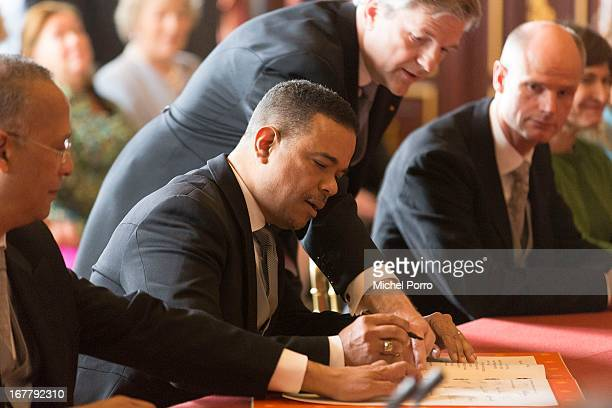 Minister Plenipotentiary of Aruba Edwin Abath signs the Act of Abdication of Queen Beatrix of the Netherlands in the Moseszaal at the Royal Palace on...
