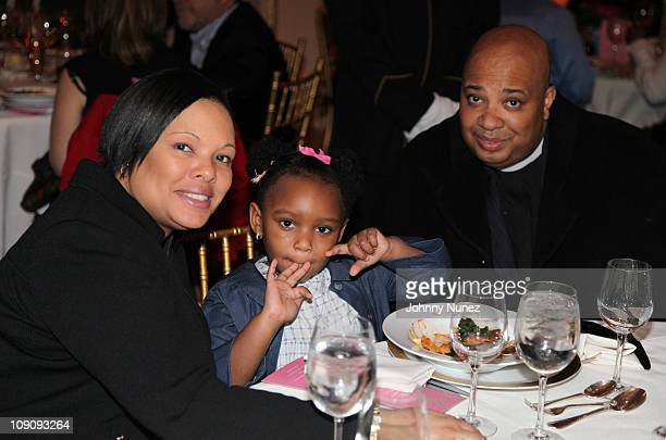 Minister recording artist and TV personality Joseph 'Rev Run' Simmons wife Justine Simmons and daughter Miley Justine Simmons attend the Rush HeARTS...