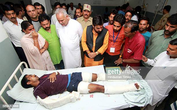 Minister Sham Choudhary inquiring the condition of an injured in a crude bomb explosion near the temple which is the main transit camp for pilgrims...