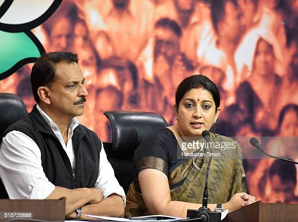 Minister Smriti Irani and BJP senior leader Rajiv Pratap Rudy during the press conference at BJP Headquarters on March 15 2016 in New Delhi India...