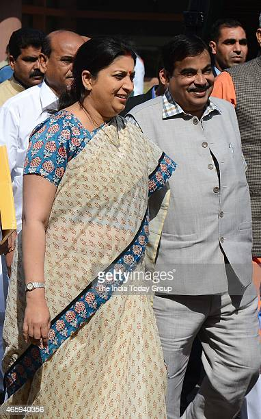 Minister Smriti Irani and Road Transport minister Nitin Gadkari coming out after the BJP Parliamentary Board meeting in New Delhi