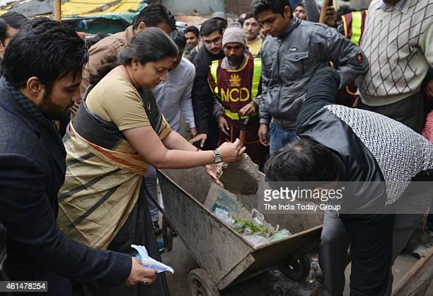HRD minister Smriti Zubin Irani with DUSU Student Union Organization Cleanliness Drive at Sanjay Basti in New Delhi