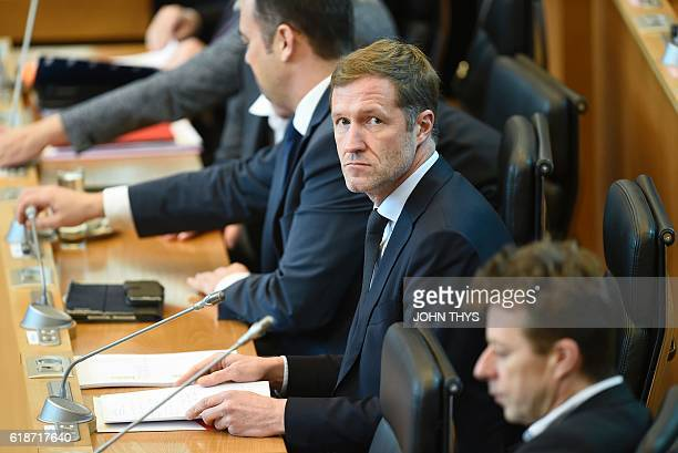 MinisterPresident of Belgium's Frenchspeaking Walloon Region Paul Magnette looks on during a debate about the EUCanada Comprehensive Economic Trade...