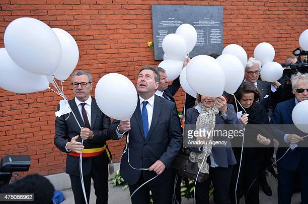 Minister-President of the Brussels-Capital Region Rudi Vervoort and Mayor of Brussels Yvan Mayeur release during a ceremony marking the 30th...