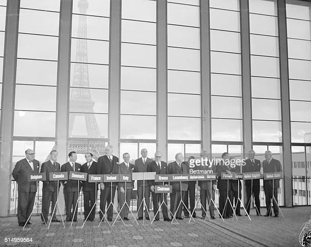 Ministers and delegates to the 14 nation NATO council pose in front of the Eiffel Tower before the opening of the meeting on Germany at the Palais de...