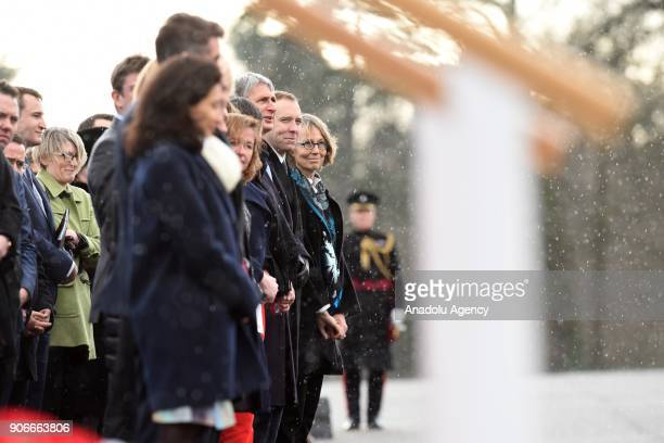 Ministers including Chancellor of the Exchequer Philip Hammond wait for British Prime Minister Theresa May and French President Emmanuel Macron...