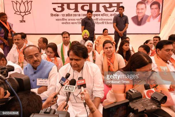BJP ministers Meenakshi Lekhi Suresh Prabhu Vijay Goel and others during a daylong hunger strike to protest against the disruption of Parliament by...