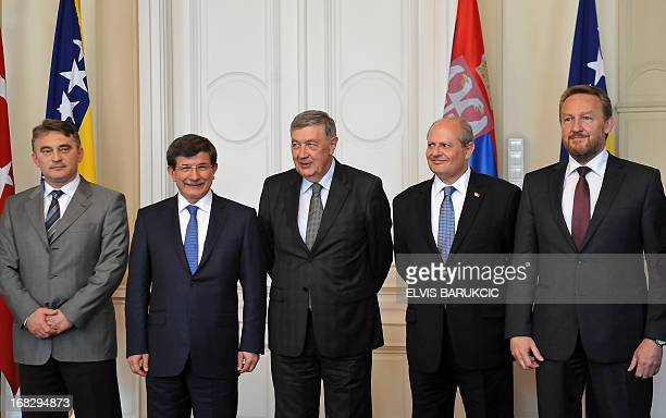Ministers of foreign Affairs of Turkey Ahmet Davutoglu and Ivan Mrkic of Serbia pose for photographers prior to a meeting with members of tripartite...