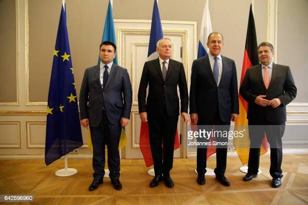 Ministers of foreign affairs Pavlo Klimkin JeanMarc Ayrault Sergey Lavrov and Sigmar Gabriel pose prior to a fourlateral meeting at the 2017 Munich...