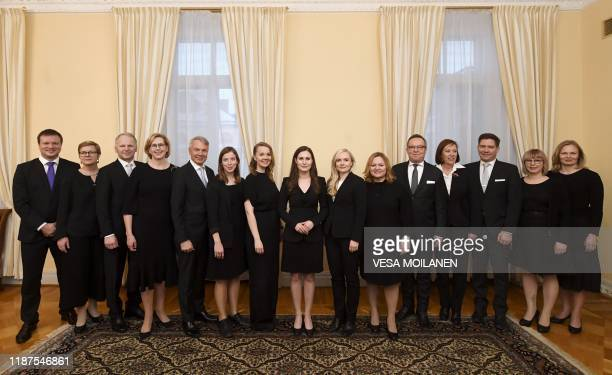 TOPSHOT Ministers of the new Finnish government lead by Prime Minister Sanna Marin pose for a family photo in Helsinki Finland on December 10 2019...