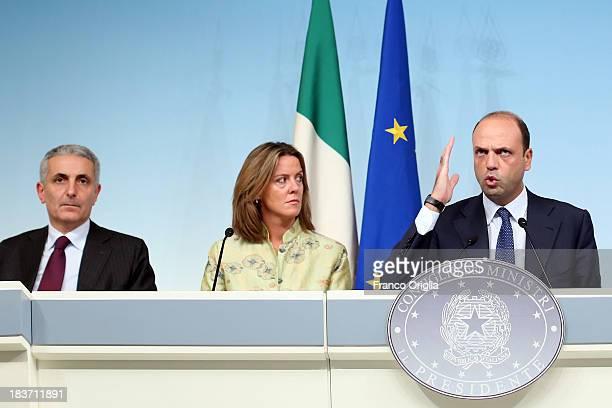 ROME ITALY OCTOBER 09 Ministers of the PDL Gaetano Quagliariello Beatrice Lorenzin and Angelino Alfano attend a press conference at Palazzo Chigi on...