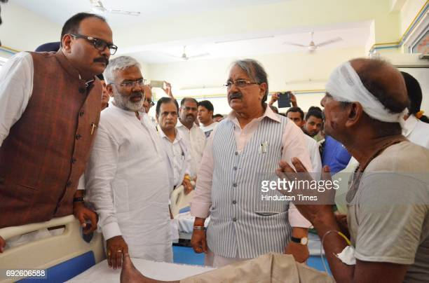 UP ministers Rajesh Agarwal Swatantra Dev Singh and Brajesh Pathak meeting with critically injured passengers at a hospital on June 5 2017 in...