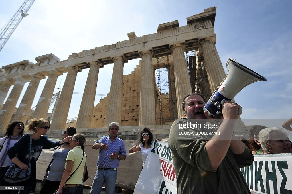 Ministry of Culture employees protest atop the Acropolis archaeological site in front of the Parthenon temple on May 25, 2010. Greek state employees hijacked a restoration event at the Acropolis in Athens on Tuesday as the government tries to force through unpopular wage cuts and hiring freezes to cut massive debt. Around 200 culture ministry staff staged a protest at the Acropolis, Greece's best-known ancient monument, to demand permanent jobs after being hired on short-term contracts for years. AFP PHOTO / Louisa Gouliamaki
