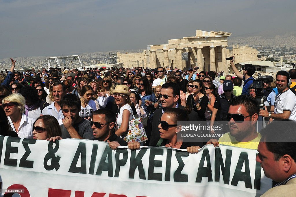 Ministry of Culture employees protest atop the Acropolis archaeological site on May 25, 2010. Greek state employees hijacked a restoration event at the Acropolis in Athens on Tuesday as the government tries to force through unpopular wage cuts and hiring freezes to cut massive debt. Around 200 culture ministry staff staged a protest at the Acropolis, Greece's best-known ancient monument, to demand permanent jobs after being hired on short-term contracts for years. AFP PHOTO / Louisa Gouliamaki